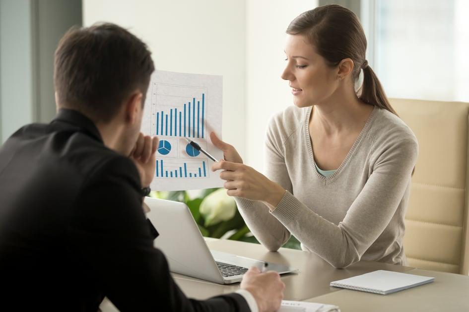 female-financial-adviser-explaining-business-plan